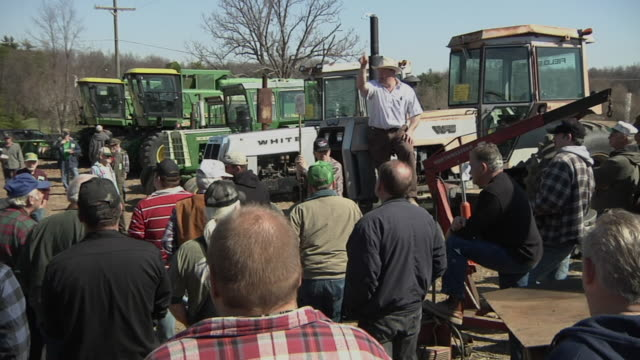 ws auctioneer selling farm equipment to crowd of buyers, whitmore lake, michigan, usa - auction stock videos and b-roll footage