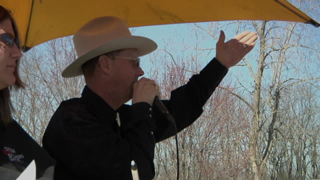 ms pan auctioneer selling farm equipment to crowd of buyers, whitmore lake, michigan, usa - auction stock videos & royalty-free footage
