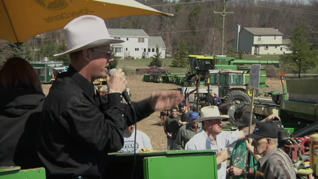 ms zo auctioneer selling farm equipment to crowd of buyers, whitmore lake, michigan, usa - auction stock videos and b-roll footage
