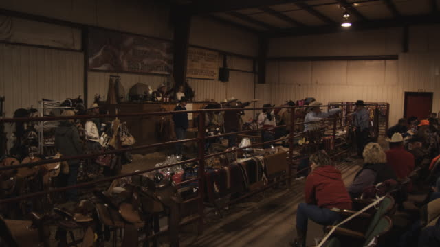 auctioneers point toward the crowd during an auction. - auction stock videos & royalty-free footage