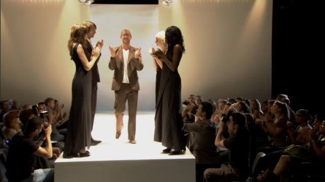 ws audience and models applauding designer on catwalk, then he bows / london, england, uk - fashion designer stock videos and b-roll footage