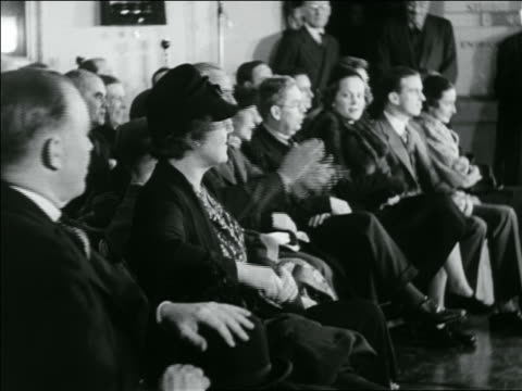 B/W 1936 audience at shaving contest clapping + shouting / newsreel