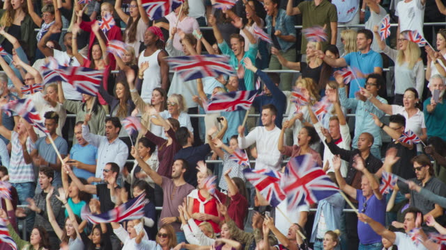 LD Audience at the stadium waving Union Jack flags
