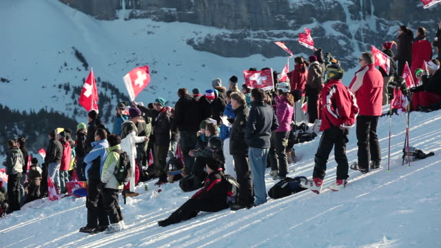 MS Audience cheering at lauberhorn ski race / Wengen, Bernese Oberland, Switzerland