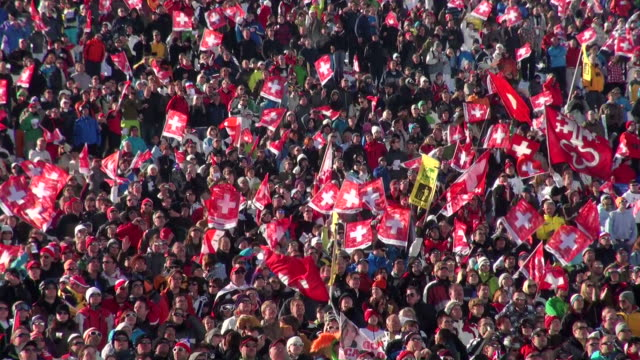 MS Audience cheering at ski race  / Wengen, Bernese Oberland, Switzerland