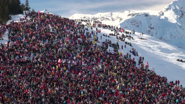 WS Audience cheering at ski race  / Wengen, Bernese Oberland, Switzerland