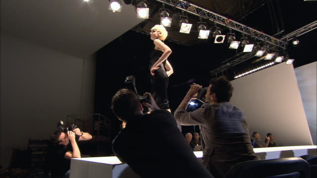 ms audience clapping at end of fashion show/ tu ms pan models walking onto catwalk and clapping/ london, england - fashion show stock videos & royalty-free footage