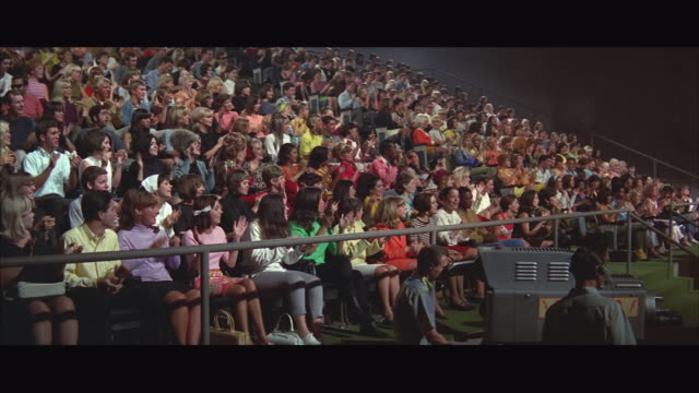 1967 ws audience clapping at tv show, camera man in foreground - television show stock videos & royalty-free footage