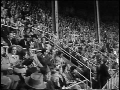 audience clapping + cheering in yankee stadium during world series / nyc - 1956 stock-videos und b-roll-filmmaterial