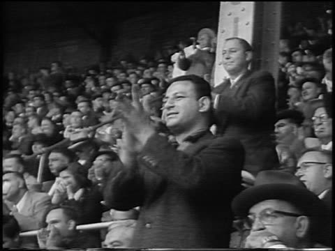 audience clapping in yankee stadium during world series / nyc / newsreel - 1956 stock-videos und b-roll-filmmaterial