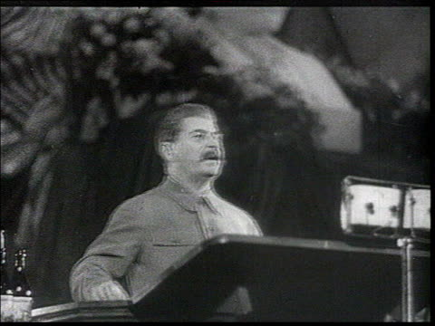 vídeos de stock e filmes b-roll de ws audience clapping cu smiling faces cu stalin looking at crowd stroking his moustache stalin's speech he thanks the voters for having put their... - joseph stalin