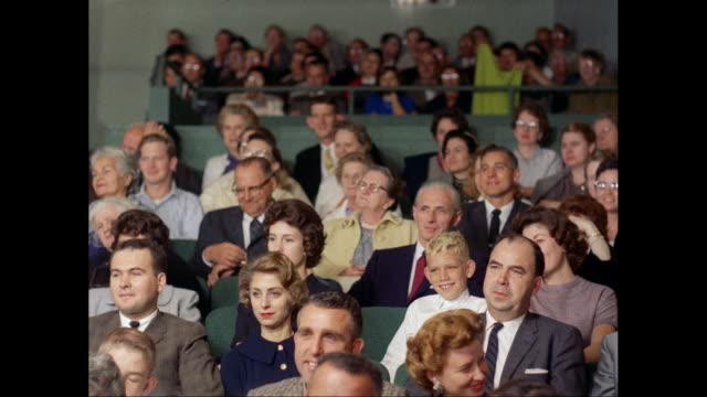 vidéos et rushes de ms pan audience enjoying in theatre / united states - 1960