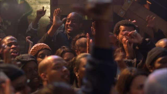 ms audience enjoying music in nightclub - hip hop stock videos & royalty-free footage