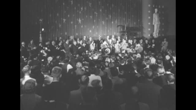 audience from behind, stage in front with pres. harry truman at podium, people on stage and in audience on feet clapping, curtains with stars in bg /... - lectern stock videos & royalty-free footage