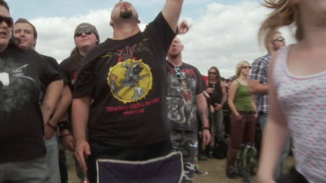 MS PAN ZI ZO Audience head banging at music festival / Knebworth, Hertfordshire, UK