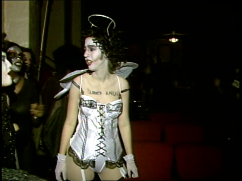 vidéos et rushes de audience in costumes at a rocky horror picture show screening - 1985