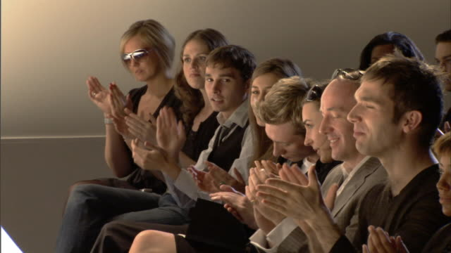 ms audience in front row applauding and smiling / london, england, uk - fashion show stock videos & royalty-free footage