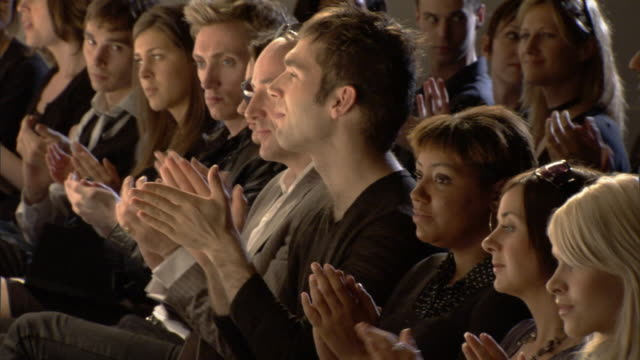 vidéos et rushes de ms pan audience in front row applauding / london, england, uk - fashion show