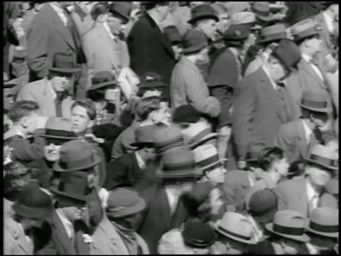b/w 1934 audience in hats watching and standing up / philadelphia / newsreel - 1934 stock-videos und b-roll-filmmaterial