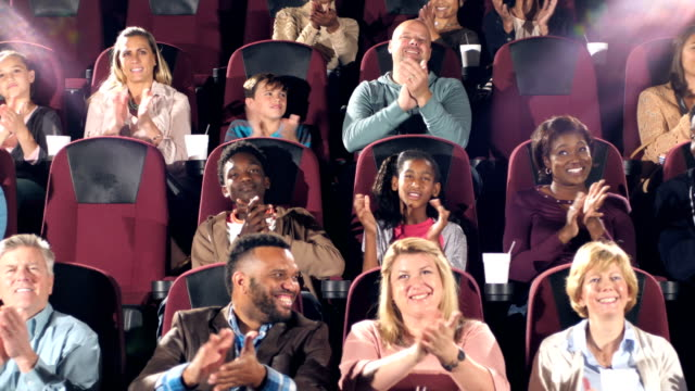 audience in movie theater start clapping - mixed age range stock videos & royalty-free footage