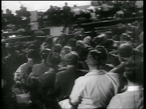 view audience in stands at huskies vs knicks game / newsreel - 1946 stock videos and b-roll footage