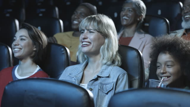 audience laughs in movie theatre, close up - film industry stock videos & royalty-free footage