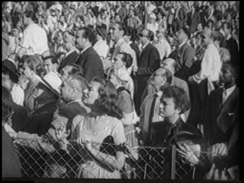 b/w 1951 audience looking with concern curiosity outdoors at boxing match / berlin / newsreel - 1951 stock videos & royalty-free footage