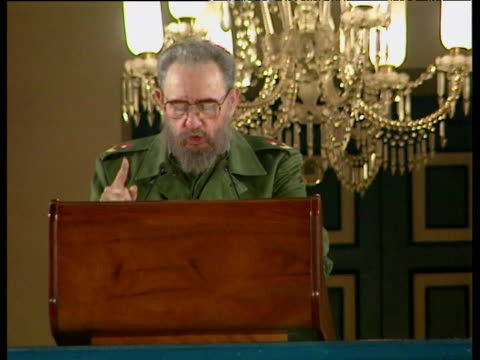 audience member dozes off during speech by president fidel castro marking 40th anniversary of revolution havana 04 jan 99 - cuba video stock e b–roll