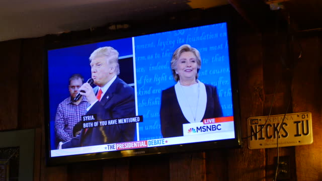 audience members at a debate watching party organized by the democratic party listen and react as hillary clinton and donald trump face off in their... - television show stock videos & royalty-free footage