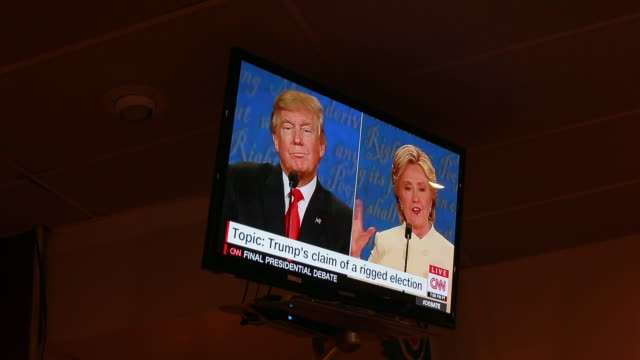 audience members at a debate watching party organized by the democratic party watch listen and react as hillary clinton and donald trump face off in... - television show stock videos & royalty-free footage
