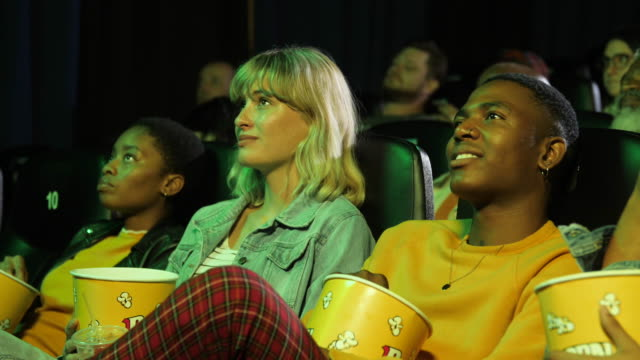 audience members watch movie while holding popcorn, close up - 20 24 years stock videos & royalty-free footage