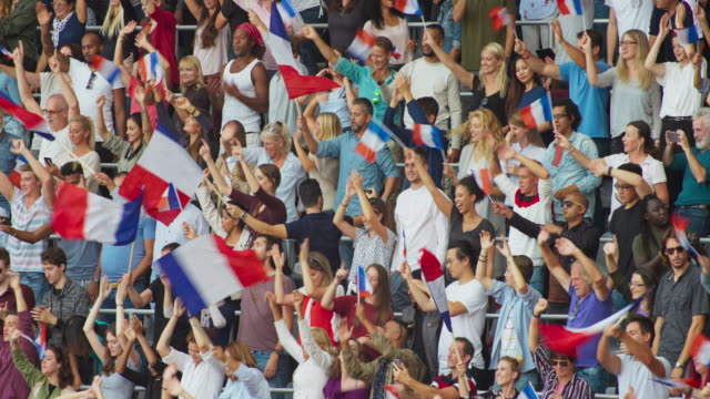 LD Audience on the stadium tribune waving French flags