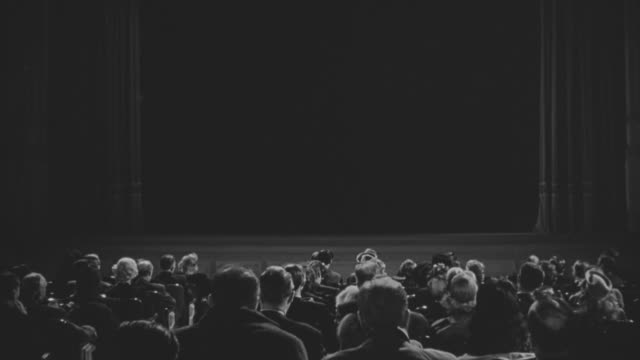 ms audience setting in movie theater - proiezione evento pubblicitario video stock e b–roll