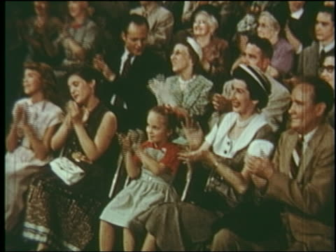1953 audience sitting in folding chairs clapping / young girl in audience - applaudire video stock e b–roll