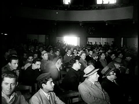 stockvideo's en b-roll-footage met b/w 1948 audience sitting listening to speech indoors / israel / documentary - 1948