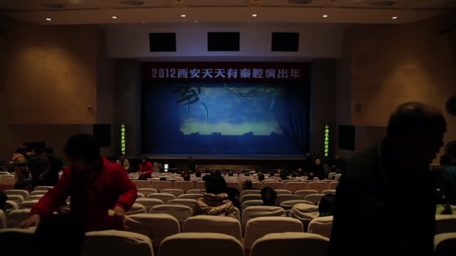 ms t/l audience taking seats in theater / xi'an, shaanxi, china - china film group stock videos & royalty-free footage