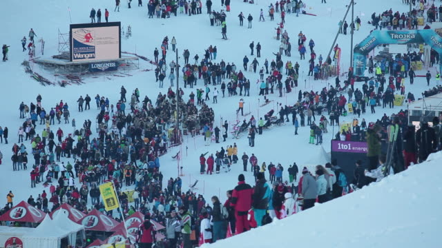 WS Audience  walking at lauberhorn ski race / Wengen, Bernese Oberland, Switzerland