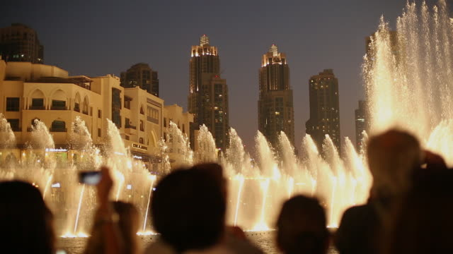 audience watches fountain show at dubai mall - tourism stock videos & royalty-free footage