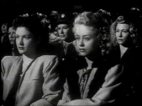 1951 montage audience watching a film and reacting with facial expressions and applause  - 映画館点の映像素材/bロール