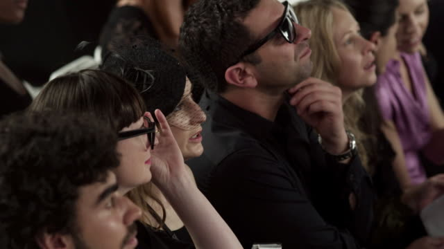vidéos et rushes de audience watching models on catwalk at fashion show - fashion show