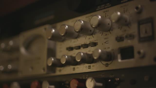audio equipment in studio, close-up - inspelningsstudio bildbanksvideor och videomaterial från bakom kulisserna