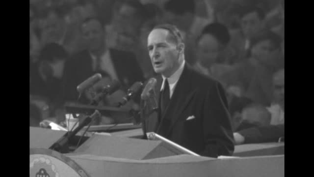 [Audio not synchronized] Four shots of Gen Douglas MacArthur wearing civilian clothing and standing on rostrum speaking during his keynote address at...