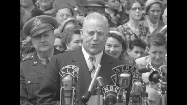 [Audio not synchronized] Man standing before bank of microphones introduces California Governor Earl Warren / CU SOT Warren begins his speech in...