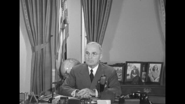 [audio not synchronized] president harry s. truman sits at desk with family photos on credenza behind, serious face as he waits then begins to speak:... - harry truman stock videos & royalty-free footage