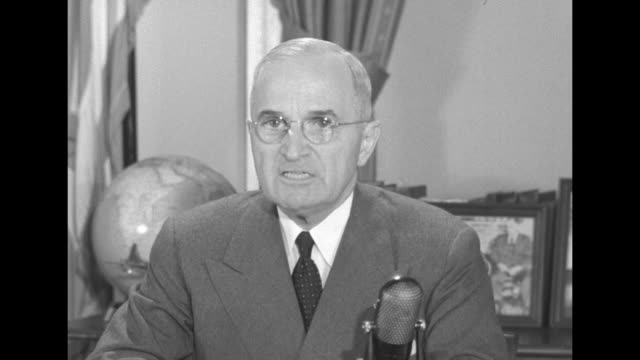 """[audio not synchronized] president harry s truman speaks to the nation while seated at a white house desk before a microphone: """"to meet the present... - korean war stock videos & royalty-free footage"""