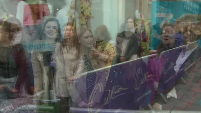 auditions for musical based on cilla black's life; england: london: ext speeded up sequence young women actors queue outside dominoin theatre cilla... - the dominion theatre stock videos & royalty-free footage