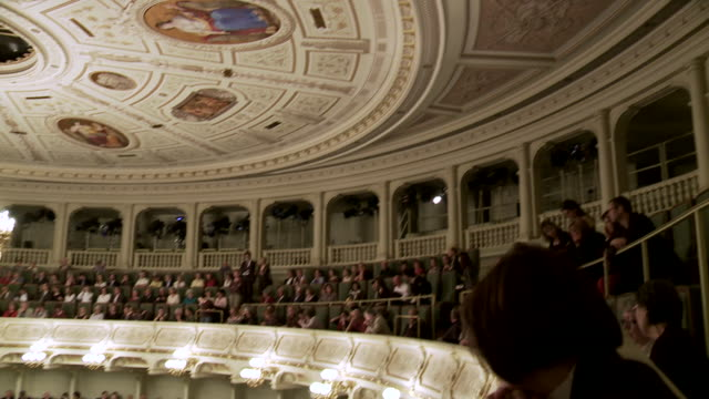 ms pan auditorium of semperopera in dresden with audience / dresden, saxony, germany - オペラ座点の映像素材/bロール