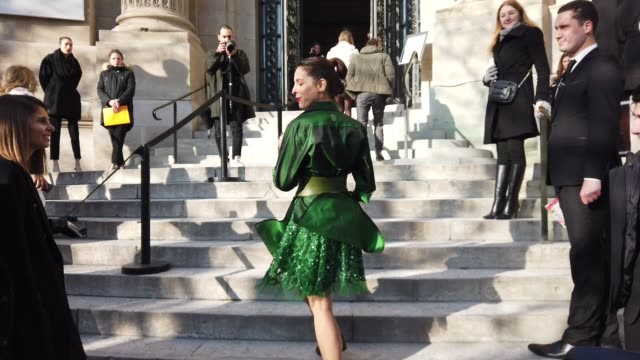 audrey dana wears green dress, earrings, outside elie saab, during paris fashion week - haute couture spring/summer 2020, on january 22, 2020 in... - paris fashion week - haute couture spring/summer 2020点の映像素材/bロール