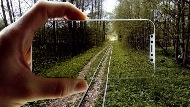 augmented reality. beautiful landscape locked in a smart phone - realtà aumentata video stock e b–roll