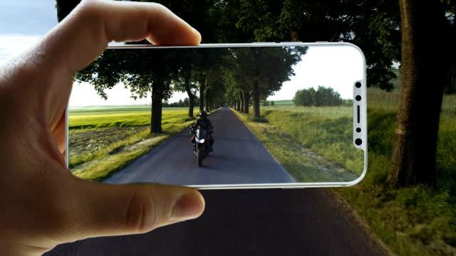 augmented-reality. welt in ein smart phone gesperrt - interaktivität stock-videos und b-roll-filmmaterial